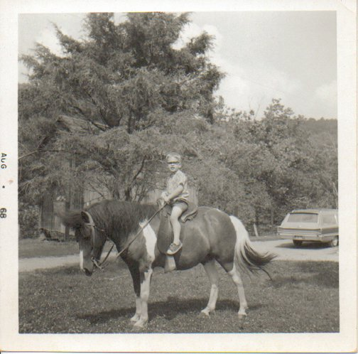 Charlie riding Princey at Uncle Mike's farm